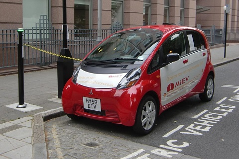 Mitsubishi i-MIEV parked at a street bay for electric vehicles
