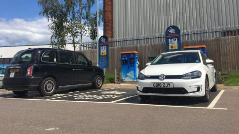 A Volkswagen and London Black Cab charging