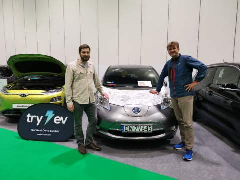 Marek poses with Arkady next to his Nissan LEAF which crossed Africa at the London Motor & Trade Show