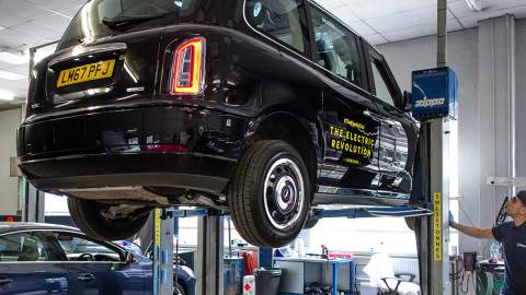 Black cab in a workshop