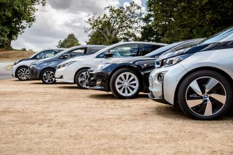 a line up of some electric vehicles