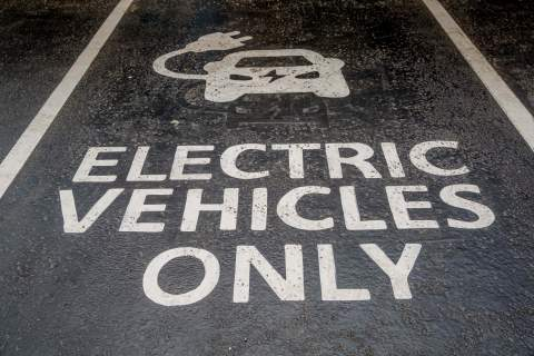 electric vehicles only, written in a parking space
