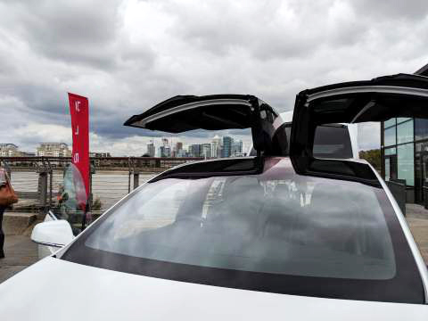 A view of The City through the open doors of the Tesla Model X