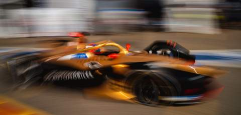 Blurred image of a Formula E car driving past