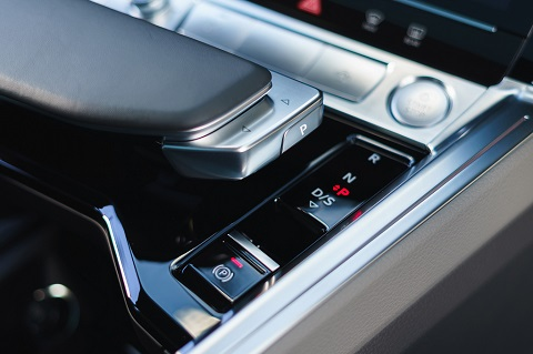 Interior close view on central console (gears control) of an Audi e-tron