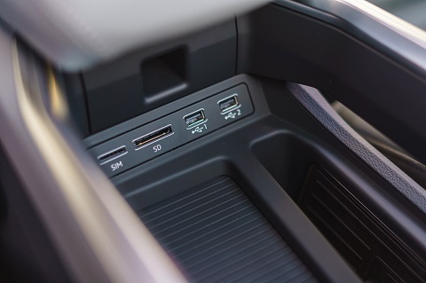 Interior close view on central console (usb and sim) of an Audi e-tron