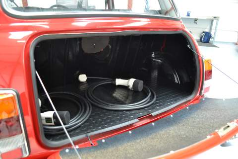 The boot of the Mini with charging cables inside