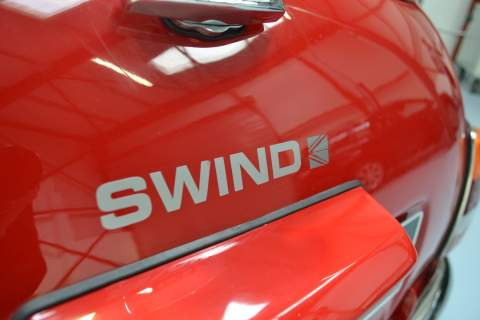 The Swind logo on the side of the Mini