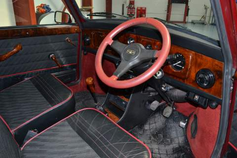 The red steering wheel of the Mini